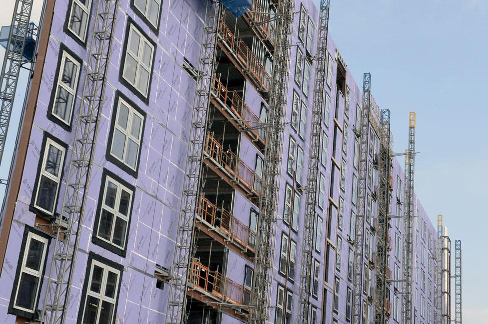 Panneau 3 en 1 pour la construction à ossature bois de moyenne et grande hauteur