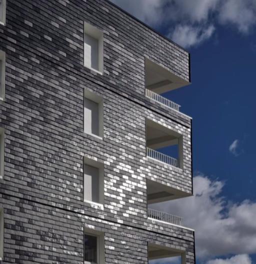 Effet de pixellisation noir et blanc avec des tuiles en façade